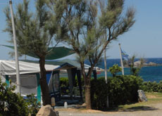 Tent pitches by the sea